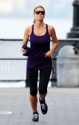 Heidi Klum gets in a tough running workout in New York on August 11th, 2012